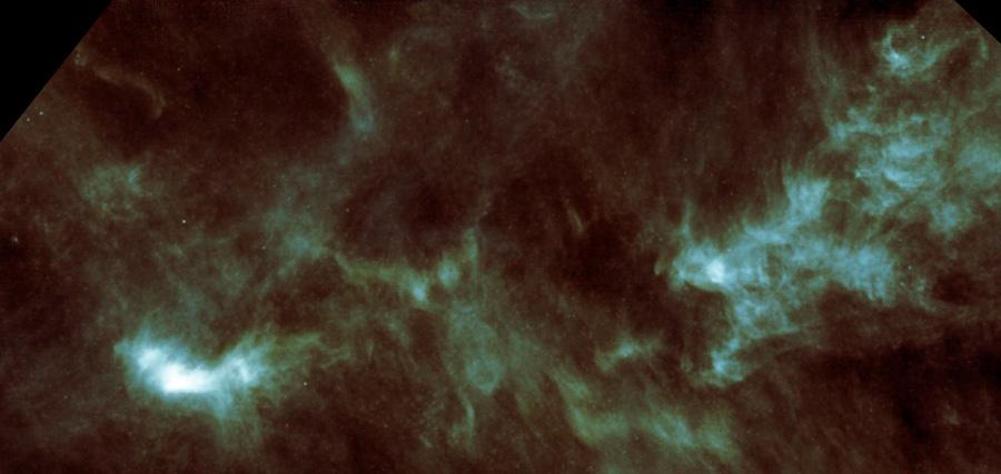 Молекулярное облако в созвездии Тельца. Находится в 450 световых годах от Земли. Яркое пятно внизу слева — область L1544, где скоро должно начаться образование звёзд. Фото: ESA/Herschel/SPIRE