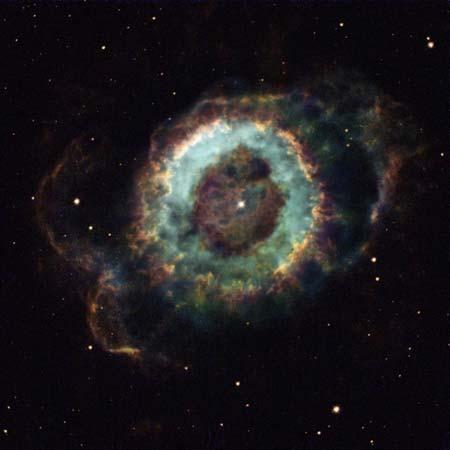 7 ноября 2002 г. Туманность «Маленький призрак»: в центре находится звезда, которая должна скоро погибнуть, ее окружает светящееся облако газа. Фото: NASA and The Hubble Heritage Team (STScI/AURA)