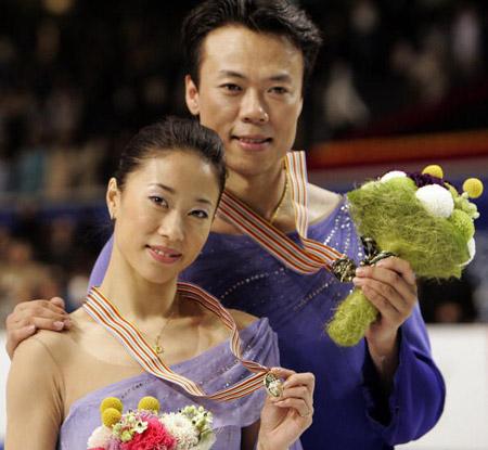 Китайські спортсмени Shen Xue (L) і Zhao Hongbo (R) на чемпіонаті світу з фігурного катання. Фото: TOSHIFUMI KITAMURA/AFP/Getty Images