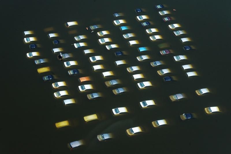 Затоплені автомобілі на заводі Honda в Таїланді. Фото: CHRISTOPHE ARCHAMBAULT/AFP/Getty Images