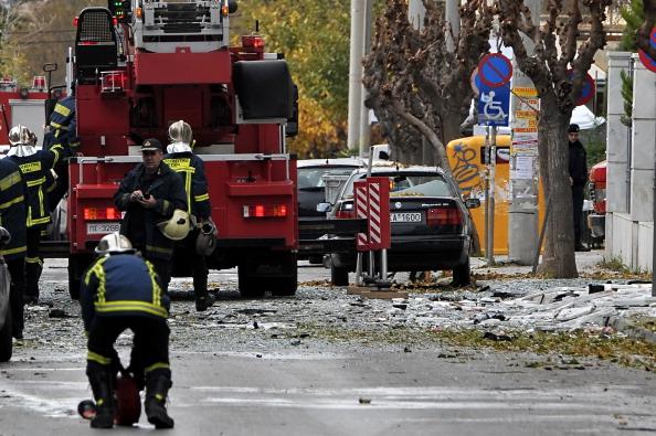 Вибух в Афінах прогримів біля будівлі адміністративного суду, 30 грудня 2010 року. Фото: LOUISA GOULIAMAKI/AFP/Getty Images