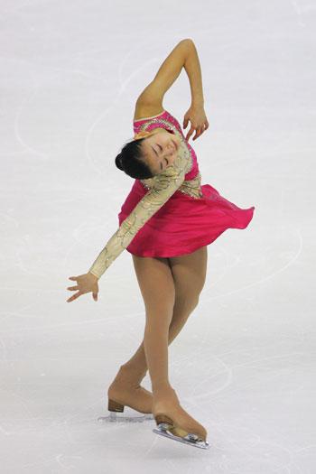 «Мисс Сайгон»: произвольная программа на этапе Гран-При - 2007 Cup of China. Фото: Feng Li/Getty Images