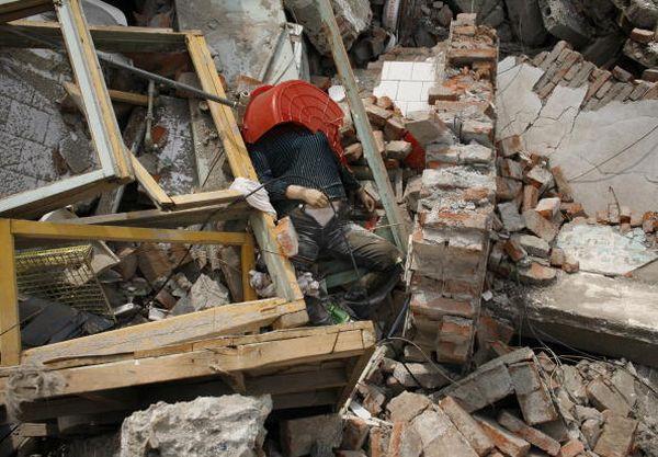 Найсильніший за останніх 30 років землетрус, приніс горе сотням тисяч людей. Фото з epochtimes.com