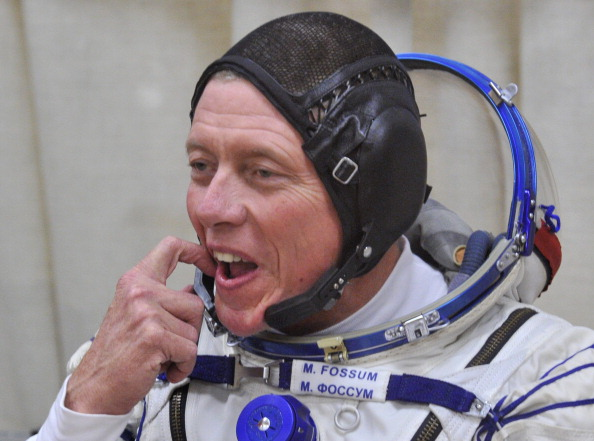 Астронавт НАСА Майкл Фоссум. Фото: VYACHESLAV OSELEDKO/AFP/Getty Images