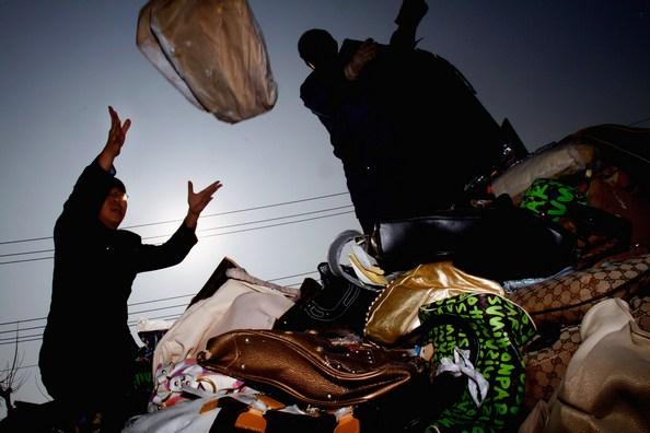 В Китае растет количество поддельных товаров. Фото: ChinaFotoPress/Getty Images