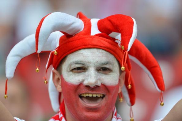 Польский болельщик на матче против России 12 июня 2012 года, Варшава. Фото: GABRIEL BOUYS/AFP/Getty Images