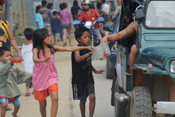 На Філіппінах у результаті тайфуну «Ваші» загинули більше 650 осіб. Фото: TED ALJIBE/AFP/Getty Images