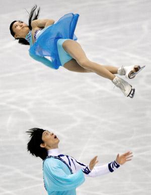 Китайська пара Tong Jian і Pang Qing на чемпіонаті в Токіо. Фото: TORU YAMANAKA/AFP/Getty Images