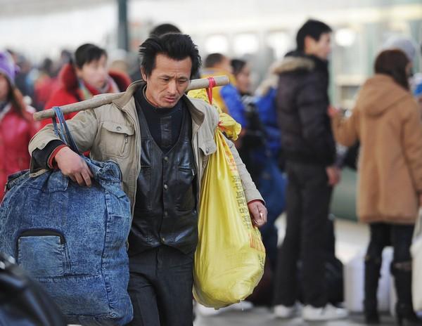 Новогодняя миграция китайцев. Город Хэфэй провинции Аньхой. 9 января 2011 год. Фото: CHINA OUT AFP PHOTO