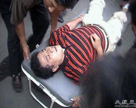 Сын Чена потерял сознание от удара - получил сотрясение мозга. Фото: Великая Эпоха